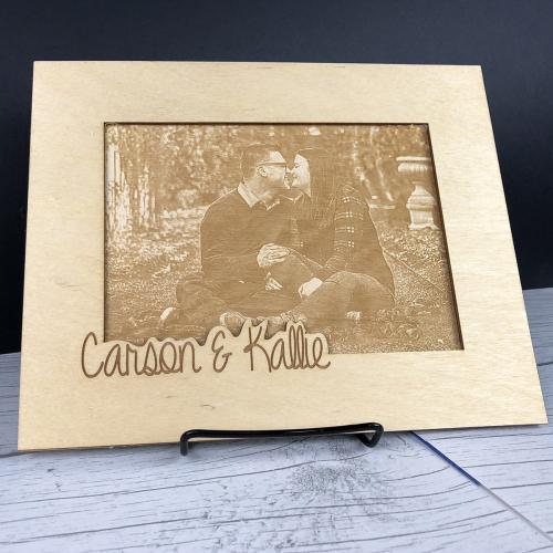 Photo etched onto woodand framed with names